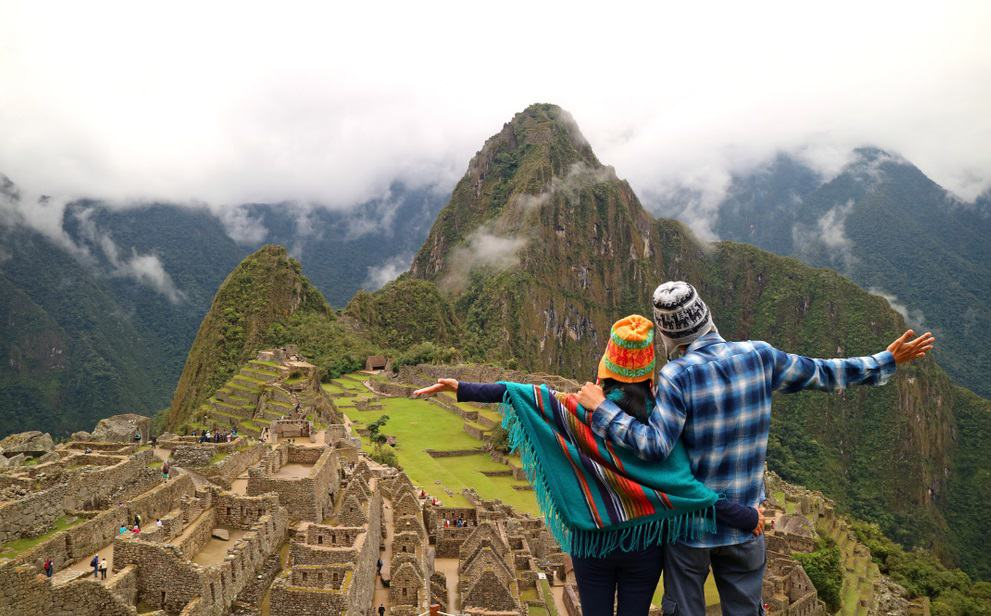 Couple admiring the spectacular view of Machu Picchu