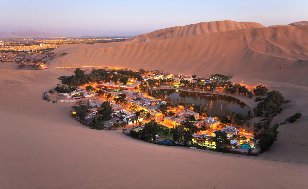Sunset in oasis Huacachina near the city of Ica, Peru